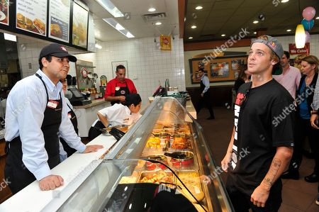 Pro skateboarder Ryan Sheckler orders lunch at Boston Market during an event benefiting The Sheckler Foundation on in North Arlington, N.J