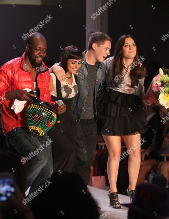 Wyclef Jean left, Jarina De Marco, Cris Cab and designer Stacy Igel are seen at the Boy Meets Girl Spring 2013 Fashion Show, on in New York