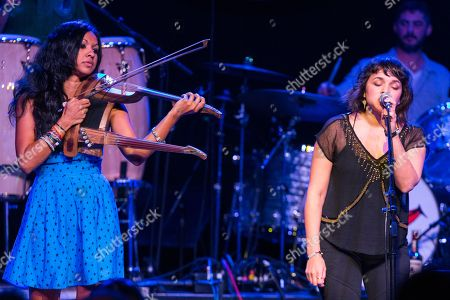 Stock Image of Gingger Shankar, left, and Norah Jones perform on stage during Brian Fest: A Night To Celebrate The Music Of Brian Wilson at the Fonda Theatre, in Los Angeles