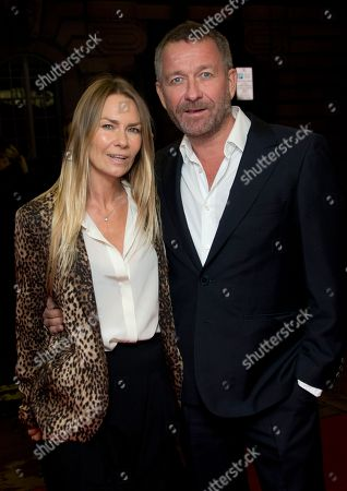 Stock Photo of British actor Sean Pertwee and Jacqui Hamilton-Smith arrive for the European Premiere of 'Dom Hemingway' at a central London cinema in Mayfair