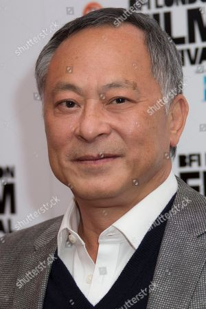 Stock Image of Johnnie To poses for photographers upon arrival at the premiere of the film 'Office', as part of the London film festival in London