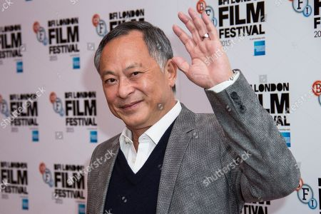 "Stock Photo of Johnnie To poses for photographers upon arrival at the premiere of the film ""Office,"" as part of the London film festival in London"