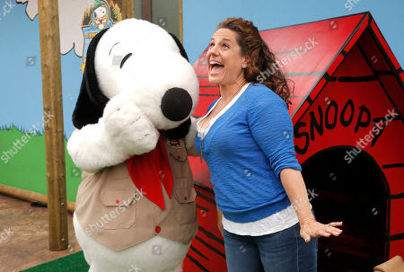 Marisa Jaret-Winokur and Snoopy attend the Camp Snoopy's 30th Anniversary VIP Party at Knott's Berry Farm on in Buena Park, California