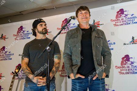 Chris Henderson, left, and Brad Arnold of 3 Doors Down seen at Charlie Daniels 80th Birthday Volunteer Jam at Bridgestone Arena on Wednesday, Nov, 30, 2016, in Nashville, Tenn
