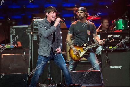 Chris Henderson, left, and Brad Arnold of 3 Doors Down perform at Charlie Daniels 80th Birthday Volunteer Jam at Bridgestone Arena on Wednesday, Nov, 30, 2016, in Nashville, Tenn