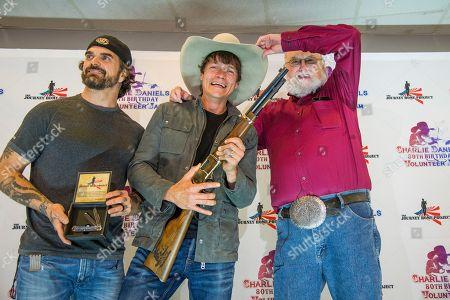 Chris Henderson, left, and Brad Arnold of 3 Doors Down seen with Charlie Daniels at Charlie Daniels 80th Birthday Volunteer Jam at Bridgestone Arena on Wednesday, Nov, 30, 2016, in Nashville, Tenn