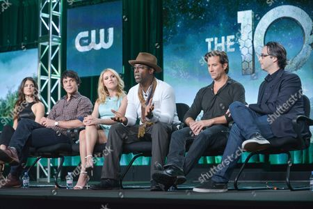 """From left, Marie Avgeropulos, Bob Morley, Eliza Taylor, Isaiah Washington, Henry Ian Cusick, and Jason Rothenberg participate in the """"The 100"""" panel discussion at the CW Winter 2014 TCA Press Tour, Wed, in Pasadena, Calif"""