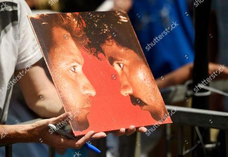 """An autograph seeker holds out a copy of the 1982 Hall & Oates album """"H2O"""" after the pop music duo received a star on the Hollywood Walk of Fame, in Los Angeles"""