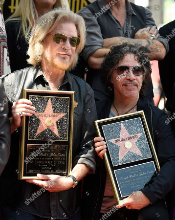 Stock Photo of Pop music duo Daryl Hall, left, and John Oates pose together during a ceremony to award them a star on the Hollywood Walk of Fame, in Los Angeles