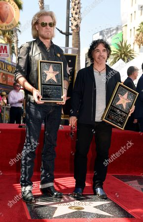 Stock Image of Pop music duo Daryl Hall, left, and John Oates pose atop their new star on the Hollywood Walk of Fame, in Los Angeles