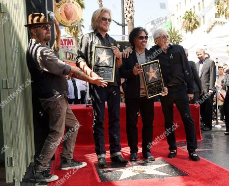 Pop music duo Daryl Hall, second from left, and John Oates, third from left, pose with musician Dave Stewart, far left, and music executive Jerry Greenberg after Hall and Oates received a star on the Hollywood Walk of Fame, in Los Angeles