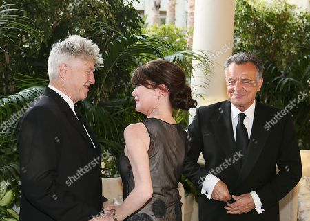 From left, artist David Lynch greets actress Lara Flynn Boyle and actor Ray Wise as the Orange County Museum of Art honors legendary Filmmaker and Visual Artist David Lynch during the 2013 Art of Dining held at the Balboa Bay Resort, in Newport Beach, Calif