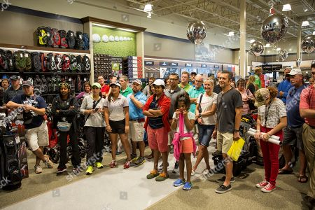 Fans take part in a Q&A with golf commentator David Feherty at the new Golf Galaxy at the Shoppes at Parkwest in Katy, TX as part of the retailer's grand opening celebration on