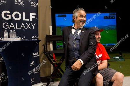 Golf commentator David Feherty has a light moment with a fan at the new Golf Galaxy at the Shoppes at Parkwest in Katy, TX as part of the retailer's grand opening celebration on
