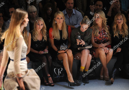 Celbrities, seated from left, AnnaSophia Robb, Paris Hilton, Cory Kennedy, Ali Wise and Rachel Zoe attend the Charlotte Ronson spring 2013 show, in New York