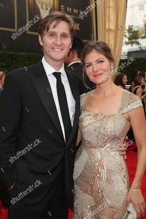 Aaron Staton, left, and Connie Fletcher arrive at the 67th Primetime Emmy Awards, at the Microsoft Theater in Los Angeles