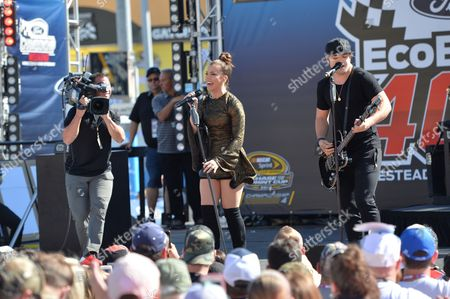 Kimberly and Neil Perry of The Band Perry performs prior to the Ford EcoBoost 400 at the Homestead Miami Speedway on in Homestead, Fla