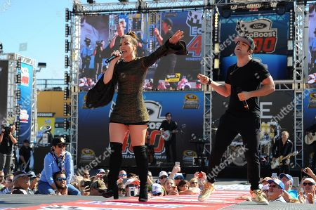 Kimberly and Neil Perry of The Band Perry perform prior to the Ford EcoBoost 400 at the Homestead Miami Speedway on in Homestead, Fla