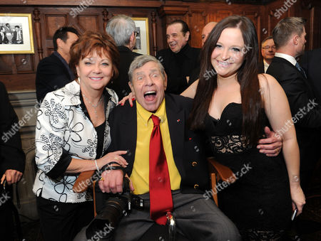 Stock Picture of Entertainer Jerry Lewis, center, his wife, SanDee Pitnick, left, and his daughter Danielle Lewis pose for a portrait at the Friars Club before his 90th birthday celebration, in New York