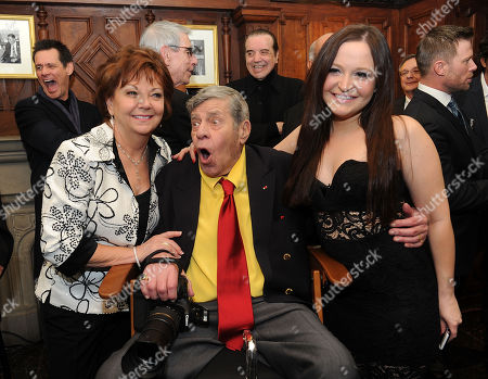Jerry Lewis, his wife, SanDee Pitnick, right, and his daughter Danielle Lewis pose for a portrait at the Friars Club before his 90th birthday celebration, in New York