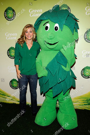 Allison Sweeney, TV host and mom, left, poses with Sprout at the Green Giant event, One Giant Pledge, on in New York. One Giant Pledge invites families to take a fun and simple oath to eat one more vegetable a day