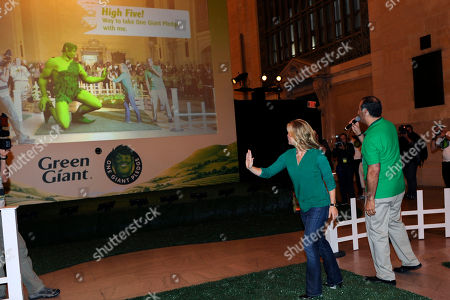 Allison Sweeney, TV host and mom, interacts with the Green Giant through augmented reality at the One Giant Pledge Event, on in New York. One Giant Pledge invites families to take a fun and simple oath to eat one more vegetable a day