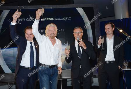 Stock Photo of Bacardi global category director Ben Farlow, left, Virgin Group founder Richard Branson, Grey Goose Maitre de Chai, Francois Thibault and Virgin Galactic CEO George Whitesides share a toast at the Grey Goose Vodka and Virgin Galactic global partnership announcement event at the Rose Center for Earth & Space, in New York