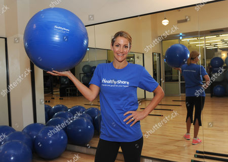Olympian and mom Summer Sanders helps launch the GE HealthyShare App for Facebook by demonstrating her workout challenge to an exercise class in New York, . Visit www.Facebook.com/Healthy to join and encourage your friends to take a step towards better health