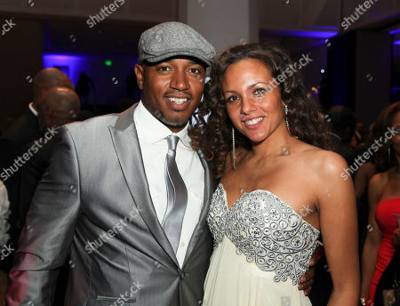 Stock Picture of From left, Peter Mott and Singer Lady Ele pose during the Hyundai NAACP Image Awards After Party, in Pasadena, Calif