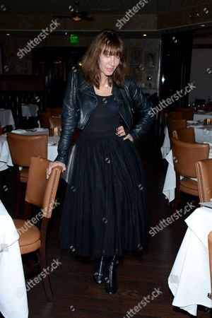 "Merle Ginsberg poses at private LA dinner for ""Song One"" screening hosted by Jean Shafiroff with director Kate Barker-Froyland and Anne Hathaway at The Palm Restaurant, in Beverly Hills, California"
