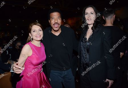 "Jean Shafiroff, Lionel Richie and Norah Lawlor pose at private LA dinner for ""Song One"" screening hosted by Jean Shafiroff with director Kate Barker-Froyland and Anne Hathaway at The Palm Restaurant, in Beverly Hills, California"