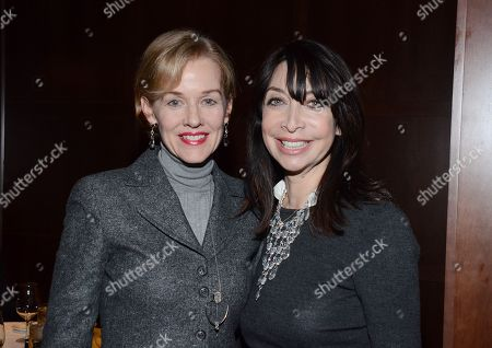 "Penelope Ann Miller and Illeana Douglas pose at private LA dinner for ""Song One"" screening hosted by Jean Shafiroff with director Kate Barker-Froyland and Anne Hathaway at The Palm Restaurant, in Beverly Hills, California"
