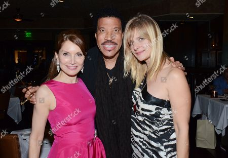 "Jean Shafiroff, Lionel Richie and Nastassja Kinski pose at private LA dinner for ""Song One"" screening hosted by Jean Shafiroff with director Kate Barker-Froyland and Anne Hathaway at The Palm Restaurant, in Beverly Hills, California"