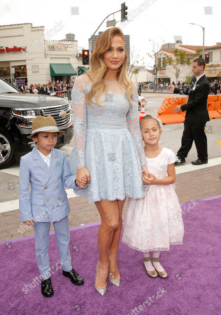 "Maximilian David Muniz, Jennifer Lopez and Emme Maribel Muniz attend the Los Angeles Premiere of ""Home"" at the Regency Village Theatre, in Westwood, Calif"