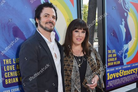 "Rob Bonfiglio, left and Carnie Wilson, arrive at the LA Premiere Of ""Love & Mercy"" at the Samuel Goldwyn Theater, in Beverly Hills, Calif"