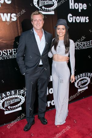 """Stock Photo of Billy Zabka, left, and Danica McKellar arrive at the LA Premiere of """"Where Hope Grows"""" held at Arclight Cinemas Hollywood on in Los Angeles"""