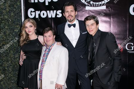 "McKaley Miller, from left to right, David DeSanctis, Kristoffer Polaha and Michael Grant arrive at the LA Premiere of ""Where Hope Grows"" held at Arclight Cinemas Hollywood on in Los Angeles"