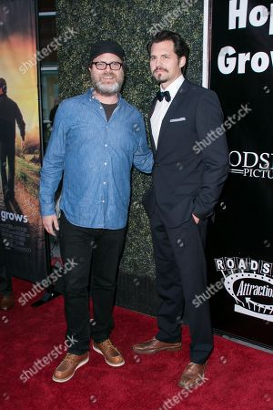 "Rainn Wilson, left, and Kristoffer Polaha arrive at the LA Premiere of ""Where Hope Grows"" held at Arclight Cinemas Hollywood on in Los Angeles"