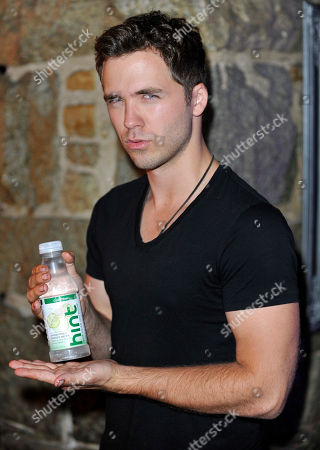 Stock Photo of Actor Stephen Lunsford poses with Hint Water at the 3rd Annual KINGS OF CON party,, in San Diego, Calif