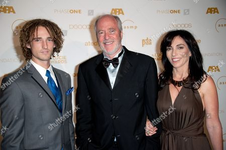 Stock Image of Greg Gorman, center, arrives at the Lucie Awards, in Beverly Hills, Calif