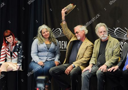 Musicians Bill Kreutzmann, second left, and Bob Weir, right, of the Grateful Dead are joined by Reya Hart, left, and Trixie Garcia, representing their fathers Mickey Hart and Jerry Garcia, at the Madison Square Garden 2015 Walk of Fame Induction ceremony, in New York