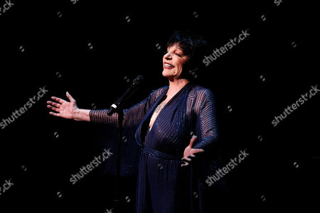 Liza Minnelli gets choked up as she performs during A Tribute to Marvin Hamlisch, a memorial concert, at The Juilliard School's Peter Jay Sharp Theater, in New York