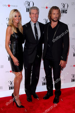 Heidi Klum, from left, Terry Lundgren and Gabriel Aubry attend the New York Fashion Week Spring/Summer 2016 30 Years of INC celebration at the IAC Building, in New York