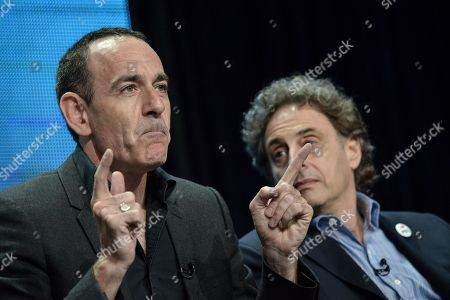 "Watergate historian Timothy Naftali, left, and Director/Writer/Producer John Scheinfeld speaks on stage during the Dick Cavett's Watergate"" panel at the PBS 2014 Summer TCA held at the Beverly Hilton Hotel, in Beverly Hills, Calif"