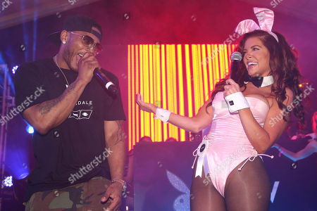 Stock Picture of Nelly and Playboy Playmate Kayla Collins sing together during the Playboy Super Bowl XLIX Party on in Scottsdale, Ariz