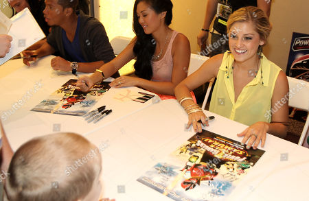 """Power Rangers Super Samurai"""" cast members Najee De-Tiege, left, Erika Fong, center, Brittany Pirtle sign autographs for fans at the Power Morphicon Convention 2012, on in Pasadena, Calif"""