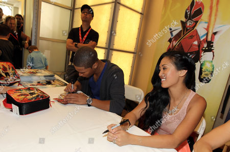 """Power Rangers Super Samurai"""" cast members Najee De-Tiege, left, and Erika Fong sign autographs for fans at the Power Morphicon Convention 2012, on in Pasadena, Calif"""