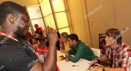 """Power Rangers Super Samurai"""" cast member Alex Heartman poses for a photo while signing autographs for fans at the Power Morphicon Convention 2012, on in Pasadena, Calif"""
