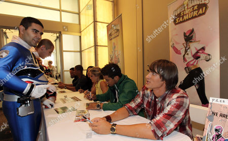 """Power Rangers Super Samurai"""" cast member Alex Heartman, right, talks to a fan while signing autographs at the Power Morphicon Convention 2012, on in Pasadena, Calif"""
