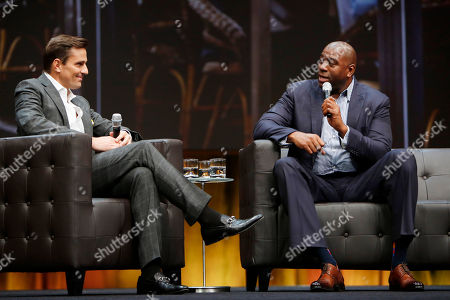 Entrepreneur, author & reality star Bill Rancic, left, and Earvin Magic Johnson, CEO, Magic Johnson Enterprises, speak in front of small businesses, entrepreneurs, developers and accountants at Intuit QuickBooks Connect on in San Jose, Calif